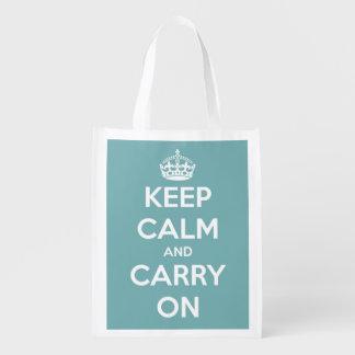 Mantenga tranquilo y continúe el azul y el blanco bolsas para la compra