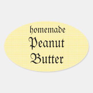 Mantequilla de cacahuete hecha en casa en una calcomanías de ovaladas