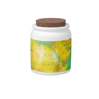 Many arms of children with hands holding globe candy dish