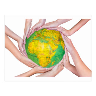 Many arms of children with hands holding globe postcard