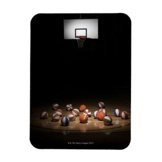 Many basketballs resting on the floor magnet