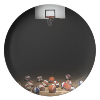 Many basketballs resting on the floor plate