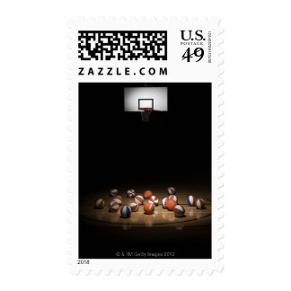 Many basketballs resting on the floor postage