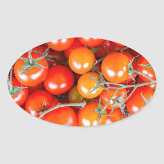 Many bunches of red vine tomatoes oval sticker