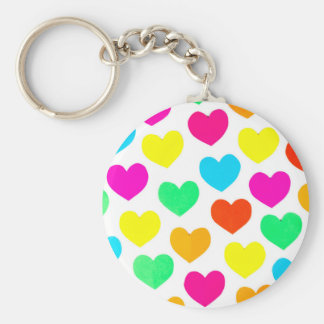 Many colorful cut paper hearts isolated on white keychain