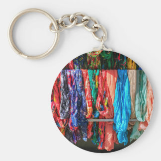 Many colorful scarves hanging at market keychain