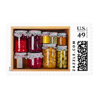 Many Glass Bottles With Preserved Food Postage Stamps
