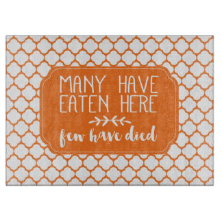 Many Have Eaten Here Few Have Died | Orange Cutting Board