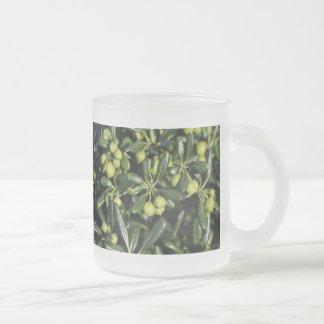 Many little green balls inside shiny vegetation coffee mug