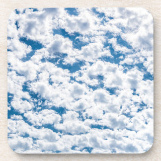 Many little white clouds and blue sky beverage coaster