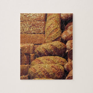 Many mixed breads and rolls background puzzle