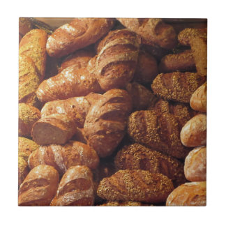 Many mixed breads and rolls background tile