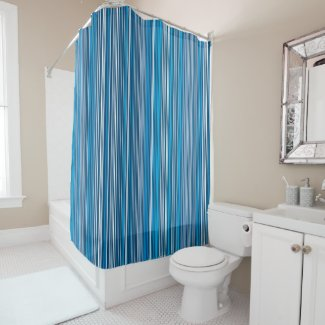 Many multi colored stripes in the blue shower curtain