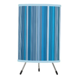 Many multi colored stripes in the blue... tripod lamp