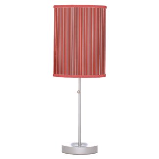 Many multi colored strips in red table lamp