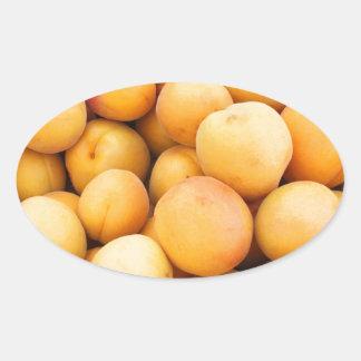 Many Peaches at a Market Oval Sticker
