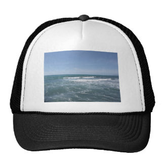 Many people surfing on surfboards in the sea trucker hat