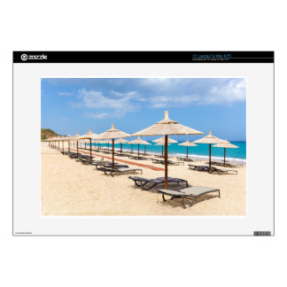 """Many reed beach umbrellas in a row  on empty beach skin for 15"""" laptop"""