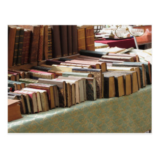 Many second hand books at antique market postcard