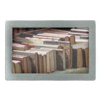 Many second hand books at antique market rectangular belt buckle
