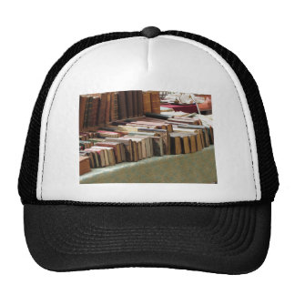 Many second hand books at antique market trucker hat