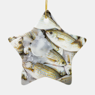 Many small caught dead fish with ice on market ceramic ornament