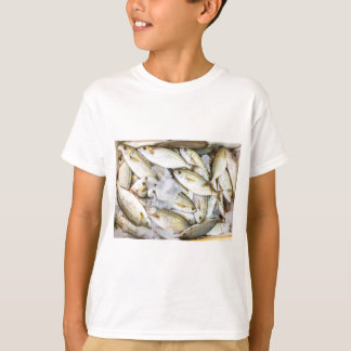 Many small caught dead fish with ice on market T-Shirt