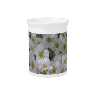 many small flowers, white beverage pitcher