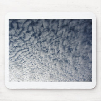 Many soft clouds against blue sky background mouse pad