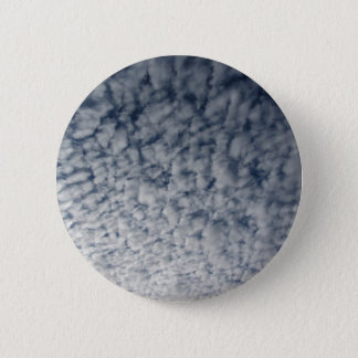 Many soft clouds against blue sky background pinback button