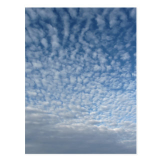 Many soft clouds against blue sky background postcard