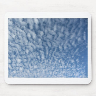 Many soft little clouds against sky background mouse pad