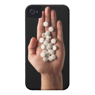 Many white pills in the palm of a person iPhone 4 cover