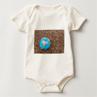 Many whole coffee beans with South America globe Baby Bodysuit