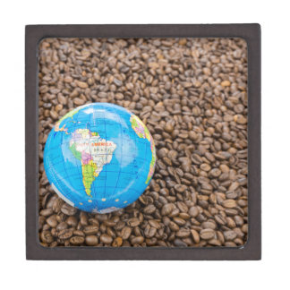 Many whole coffee beans with South America globe Gift Box