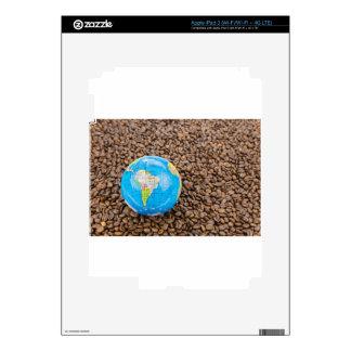 Many whole coffee beans with South America globe iPad 3 Skins