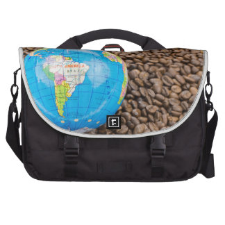 Many whole coffee beans with South America globe Laptop Bags