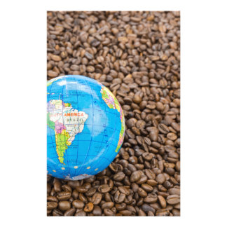 Many whole coffee beans with South America globe Stationery
