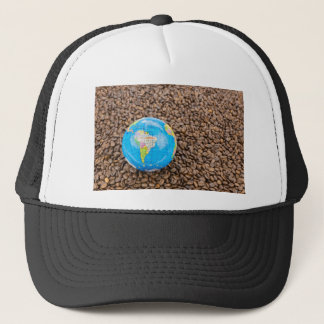 Many whole coffee beans with South America globe Trucker Hat
