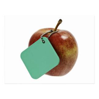 Manzana roja con la etiqueta verde postales