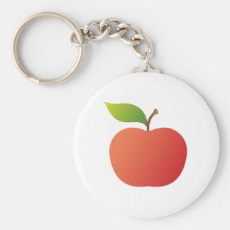 Manzana roja con llavero o el llavero de la hoja