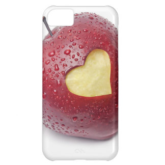 Manzana roja fresca con un símbolo en forma de cor