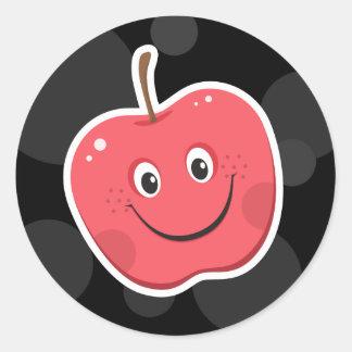 Manzana roja fresca en los pegatinas negros del fo
