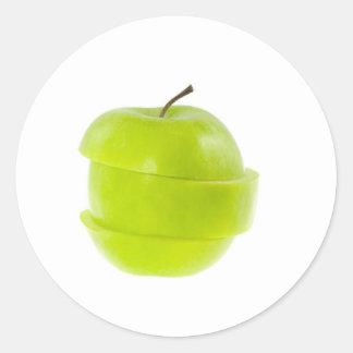 Manzana verde cortada pegatina redonda