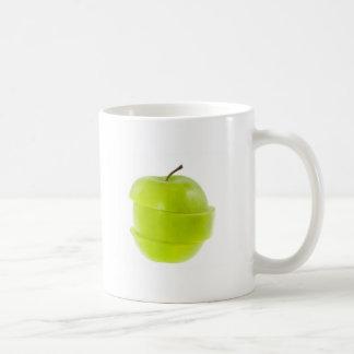 Manzana verde cortada tazas de café