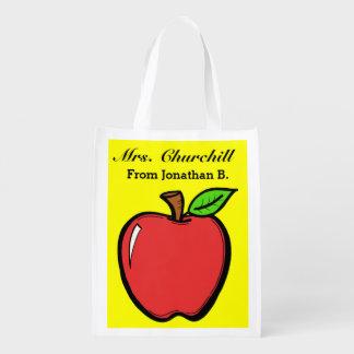 Manzanas brillantes ultramarinos, regalo, bolso de bolsa de la compra