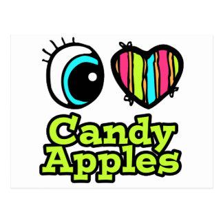 Manzanas de caramelo brillantes del amor del postales
