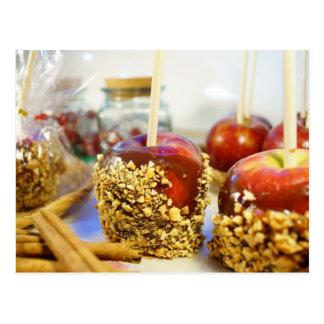 Manzanas del cacahuete del caramelo postal