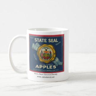 Manzanas del sello del estado de Idaho Taza