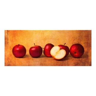 Manzanas en panorama rojo cojinete
